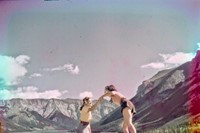 Women clambering over rocks near Morraine Lake, 1951