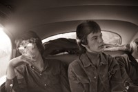 Keith and Mick in the backseat of a limousine in London in 1