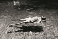 Robert Rauschenberg in Hamadabad, India, in a swim