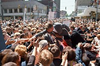 © Bill Eppridge. Bobby Kennedy with a crowd in a Midwest cit