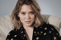 Léa wears silk embroidered jacket by Miu Miu; chiffon bra by