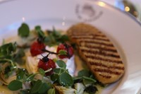 Buratta with artichokes, asparagus and roast cherry tomatoes