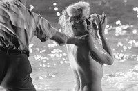 Monroe by the pool's edge, Whitey Snyder adjusting her makeu