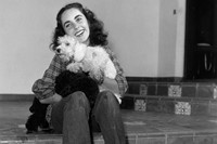 British-born actor Elizabeth Taylor, wearing a plaid shirt a