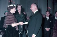 Princess Margaret presents Christian Dior with a s