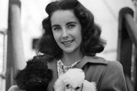 Elizabeth Taylor stands with her brother and their dog in a