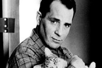 Jack Kerouac with a cat, 1965