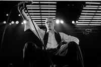 Singer David Bowie performing on stage as the Thin White Duk