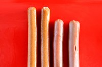 Different styles of hot dog