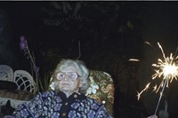Mary with sparkler on her birthday (Corinne's grandmother)