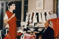 Christian Dior with model Lucky, circa 1955. Court