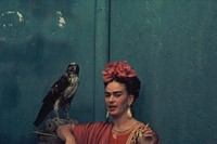 Frida Kahlo in a Tehuna costume, with her pet hawk, 1939