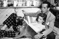 Humphrey Bogart and Lauren Bacall with their pet boxer at ho