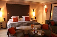 A bedroom suite at Le Cheval Blanc