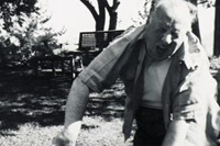 Alfred Hitchcock plays with one of his Sealyham Terriers. Ho