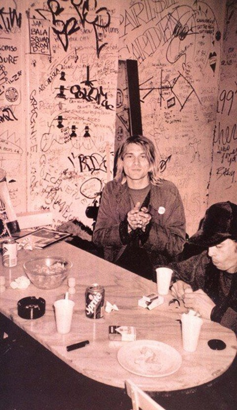 3160a15d4f Kurt Cobain surrounded by graffiti and Dave Grohl