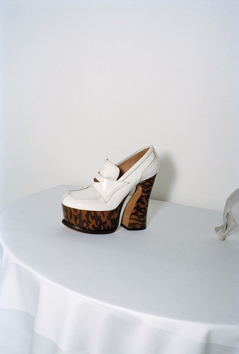 56c5ce78b5 Sculptural allure meets witty historicism in these towering platforms from  John Galliano