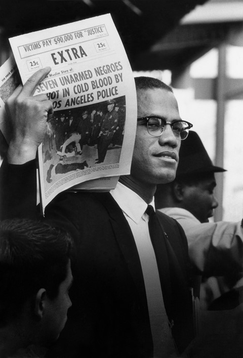 Malcolm C Holding Up Black Muslim Newspaper Chicag