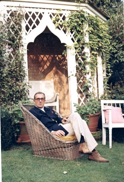 Hardy Amies relaxes in his country house, 1970s