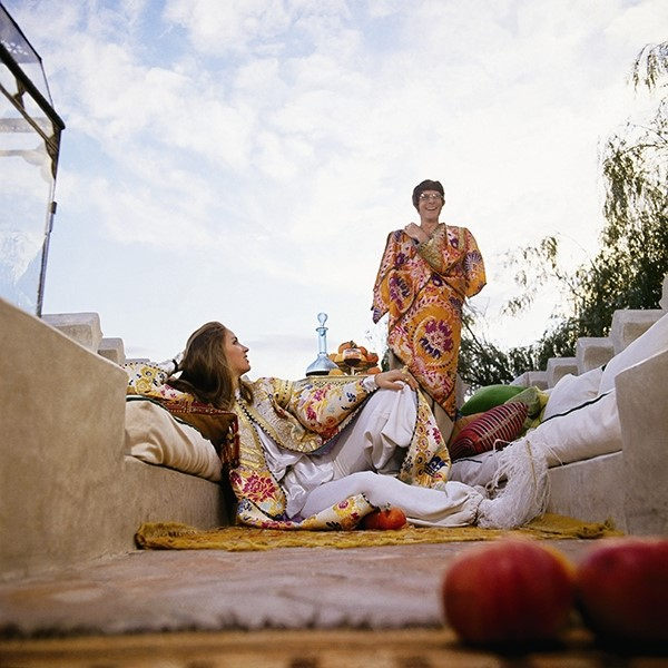 Talitha and J. P. Getty wearing his-and-hers caftans on the