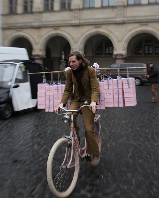 Wes Anderson going for a spin on Agatha's pink bicycle