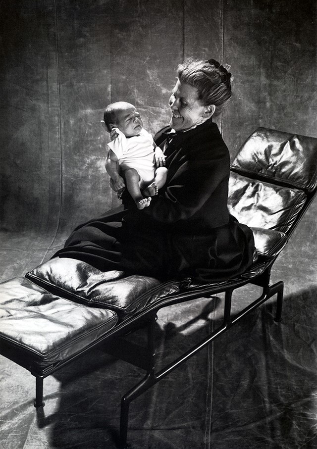 Ray Eames with great-grandchild on a Soft Pad Chaise, 1988