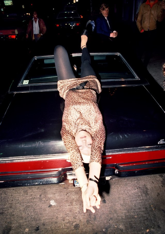 040_Woman_reclining_on_car_1977
