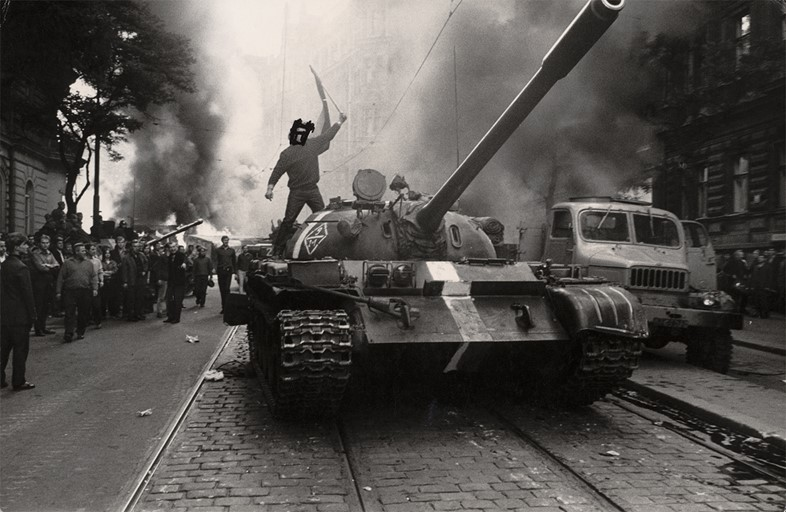 (Student on tank, eyes crossed out), from the series Invasio