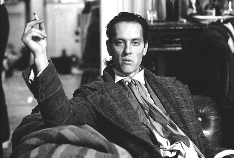 Richard E. Grant films a scene for Withnail & I, 1986