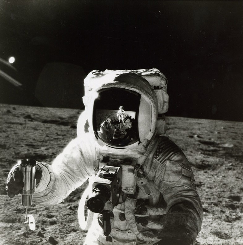 Alan Bean by Pete Conrad, with the reflection of the photogr