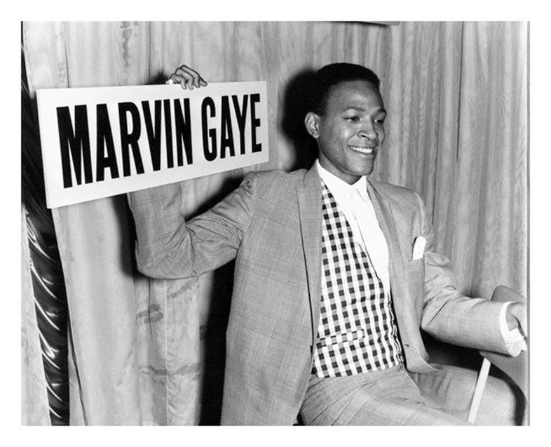 Marvin Gaye holding a sign, 1964