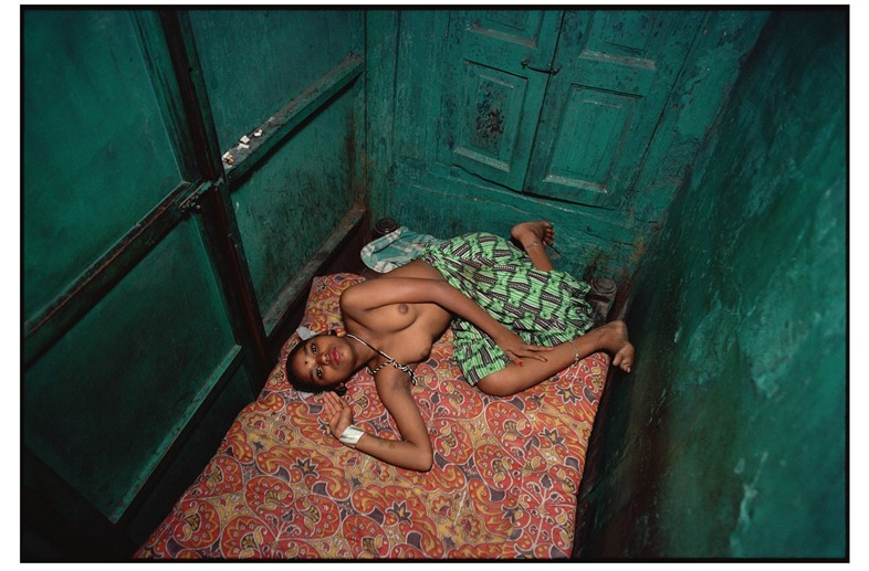 Twelve-year-old Lata lying in bed. Falkland Road,