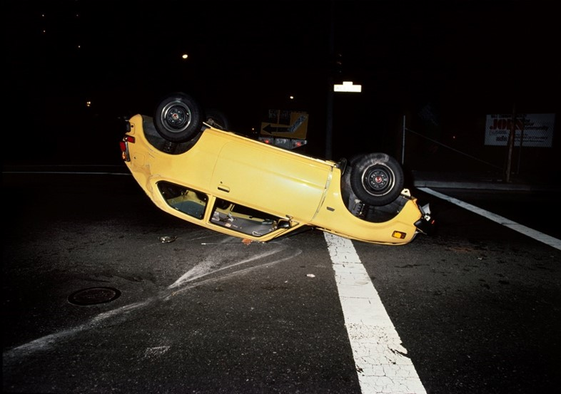 041_Upside_down_yellow_car_1980