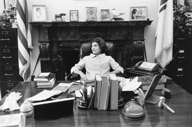 Jackie sits at JFK's senate desk, Washington DC, 1
