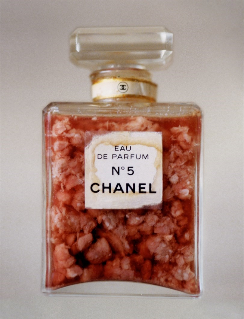 42 - CHANEL NO.5 PERFUME BOTTLE WITH RAW MEAT