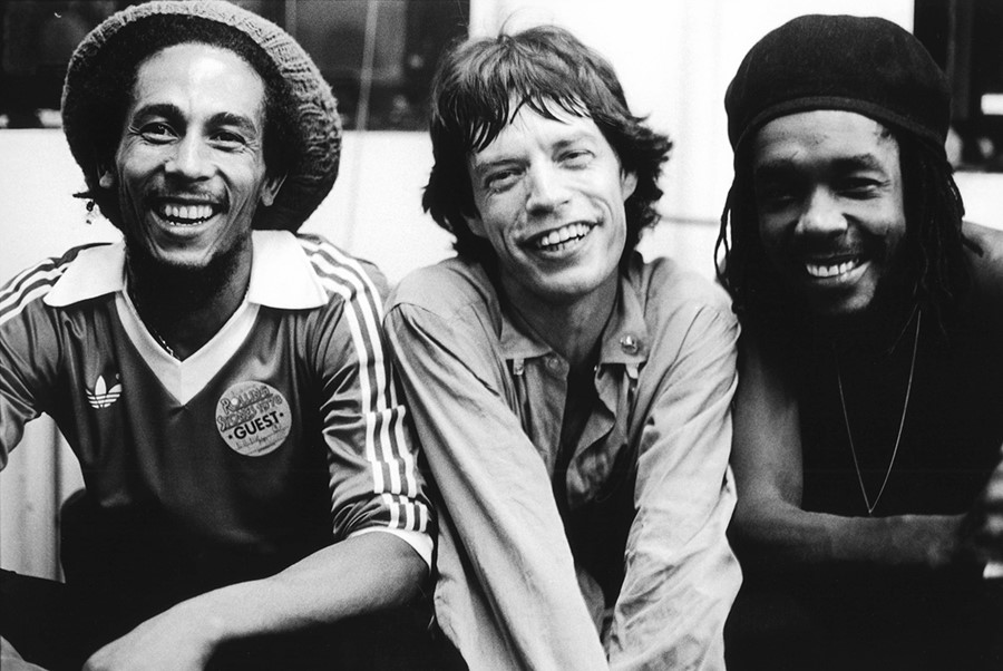 Bob Marley, Mick Jagger and Peter Tosh pose backstage at a R