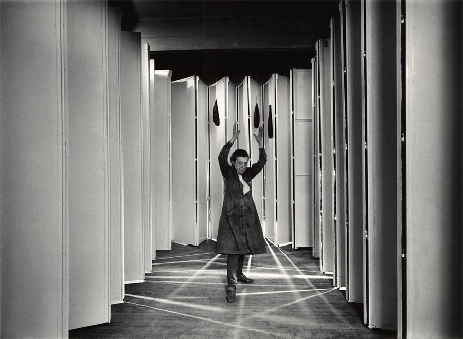 Louise Bourgeois inside Articulated Lair, 1986